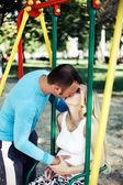Kiss parents — Stock Photo