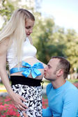 Kiss father pregnant barter in the stomach — Stock Photo