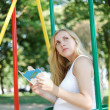 Pregnant girl with a children's book — Stock Photo #12005866