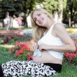 Pregnant girl with tops — Stock Photo