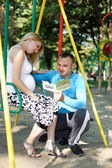 My husband is reading fairy tales pregnant wife — Stock Photo