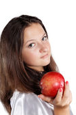 Girl offers an apple isolated — Stockfoto