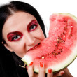 Portrait of a girl eating a watermelon — Stock Photo
