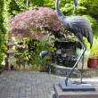 Bronze Cranes in Japanese Inspired Garden — Stock Photo