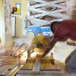 Construction Worker Cutting Metal Stud with Table Saw — Stock Photo