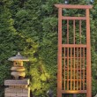 Stock Photo: Japanese Stone PagodLantern and Trellis