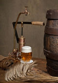 Beer with malt and spigot — Stock Photo