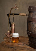 Beer and old spigot — Stock Photo