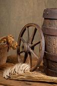 Retro still life with barrel and barley — Stock Photo