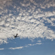 Clouds, blue sky and airplane — Stock Photo
