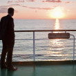 Thinking businessman and red sunset on a ferry — Stock Photo
