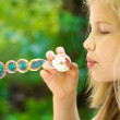 Stock Photo: Girl and bubbles