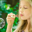 Girl and bubbles — Stock Photo