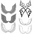 Stock Vector: Set of bird wings for heraldry design isolated on white backgrou