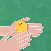 Young chicken in hand — Stock Vector