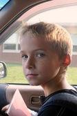 Boy In Car At School — Stock Photo