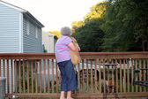 Senior Woman Holding Puppy Horizontal — Stock Photo