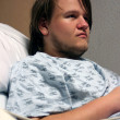 Stock Photo: Teen Boy In Hospital Bed