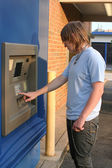 Teen Boy Using ATM — Stock Photo