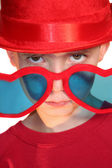 Boy Peeking Over Heart-Shaped Glasses — Stock Photo