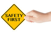 Safety First traffic sign with hand — Stock Photo