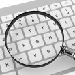 Magnifier with keyboard — Stock Photo