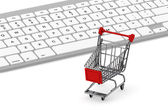 Keyboard and a shopping cart — Stok fotoğraf
