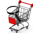 Magnifying glass & shopping trolley — Stock Photo