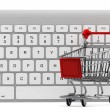 Keyboard and a shopping cart — Stock Photo