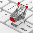 Keyboard and a shopping cart — Stock Photo #11300563