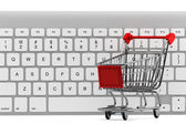 Keyboard and a shopping cart — Foto Stock