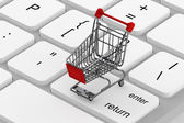 Keyboard and a shopping cart — Stok fotoğraf