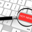 Magnifier with Hot News key - Stock Photo