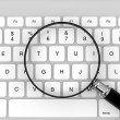 Magnifier with keyboard — Stock Photo #11414021