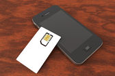 SIM card and mobile phone — Stock Photo