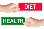 Diet and Health traffic sign in the hand — Stock Photo