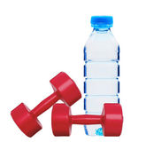 Red dumbbells fitness and bottle of water isolated on white — Stock Photo