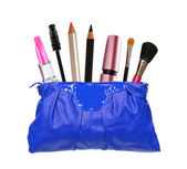 Beautiful blue makeup bag and cosmetics isolated on white — Stock Photo
