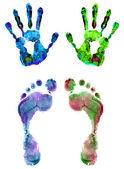 Color huellas de pies y manos aisladas en blanco — Foto de Stock
