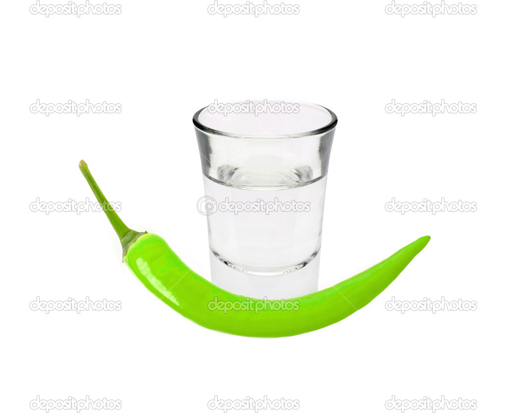 Glass of vodka and green chilli pepper isolated on white — Stock Photo #10804187