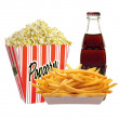 Royalty-Free Stock Photo: Full bucket of popcorn, cola in bottle and french fries potatoes