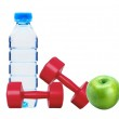 Red dumbbells fitness, green apple and bottle of water isolated — Stock Photo
