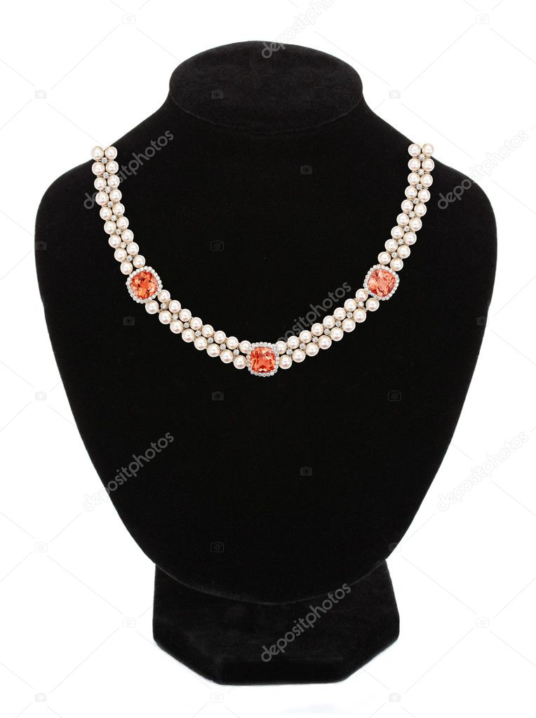 Pearl necklace with stones on black mannequin isolated on white background — Stock Photo #11092458