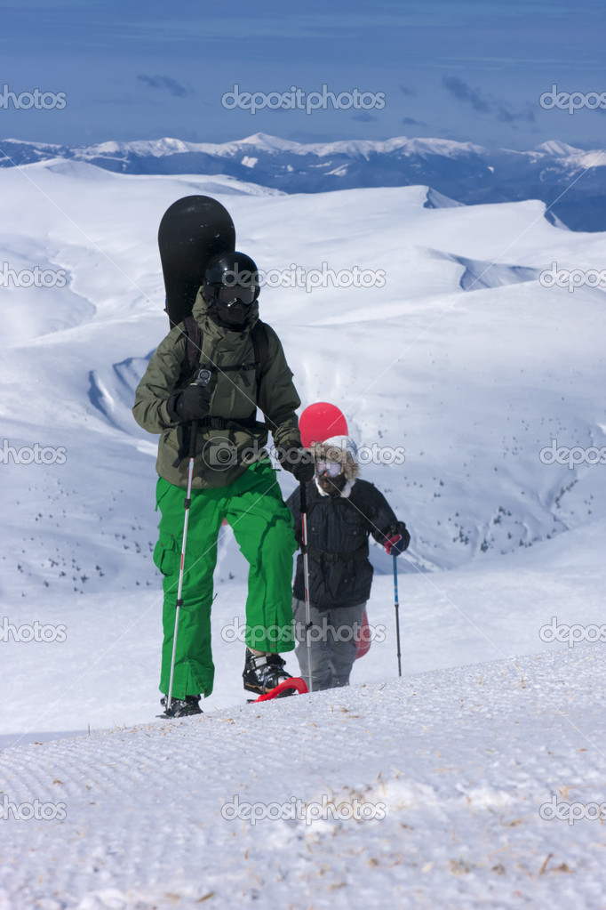 Two backcountry snowboard-freeriders are going uphill.  Stock Photo #11969646