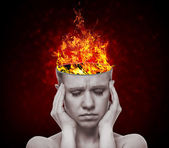 Concept, an idea. head of woman with a flame of fire — Stock Photo