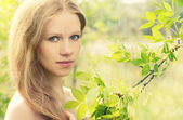 Beautiful charming mysterious girl in the forest on the nature — Stock Photo