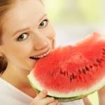 Happy girl eats the watermelon — Stock Photo #11655159