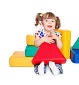 Beautiful little girl playing in the constructor — Stock Photo