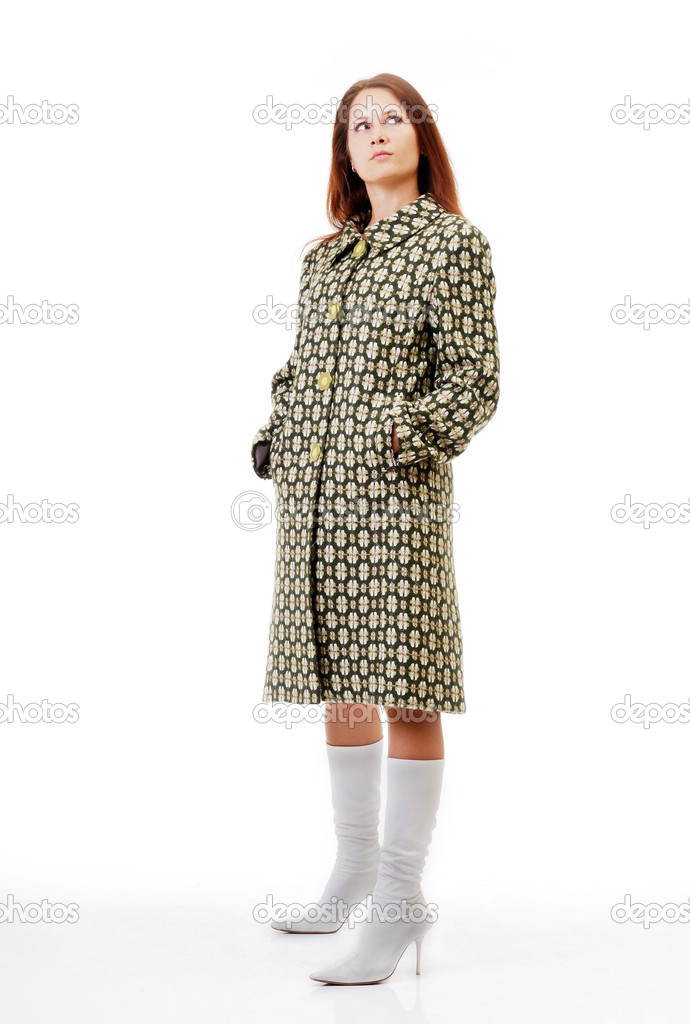 Pretty girl is standing and looking up. She is wearing an overcoat variegated and white boots high-heeled. — Stock Photo #10750676