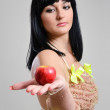 Young woman with a red apple. — Stock Photo